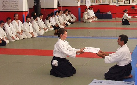 A moment during the ceremony of awarding Dan Aikikai degrees